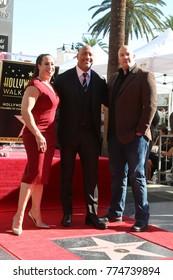 LOS ANGELES - DEC 13:  Dany Garcia, Dwayne Johnson, Hiram Garcia at the Dwayne Johnson Star Ceremony on the Hollywood Walk of Fame on December 13, 2017 in Los Angeles, CA