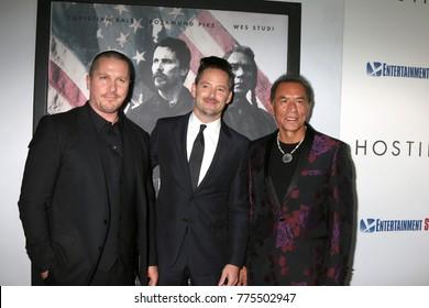 "LOS ANGELES - DEC 14:  Christian Bale, Scott Cooper, Wes Studi at the ""Hostiles"" Premiere at Samuel Goldwyn Theater on December 14, 2017 in Beverly Hills, CA"