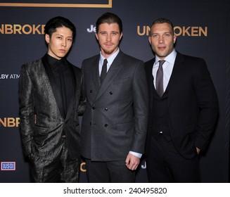 """LOS ANGELES - DEC 15:  Mayavi, Garrett Hedlund & Jai Courtney arrives to the """"Unbroken"""" US Premiere on December 15, 2014 in Hollywood, CA"""