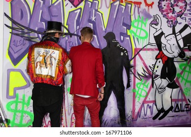 """LOS ANGELES - DEC 18:  Alec Monopoly, Justin Bieber at the """"Believe"""" World Premiere at Regal 14 Theaters on Dec 18, 2013 in Los Angeles, CA"""
