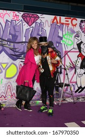 """LOS ANGELES - DEC 18:  Sandra Taylor, Alec Monopoly at the """"Believe"""" World Premiere at Regal 14 Theaters on Dec 18, 2013 in Los Angeles, CA"""