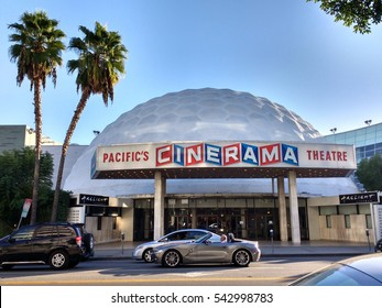 LOS ANGELES, DEC 19TH, 2016: A sports car drives past he famous Cinerama Dome movie theater on Sunset Boulevard in Hollywood.
