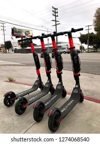 LOS ANGELES, Dec 22nd, 2018: A group of Uber Jump electric scooters stand abandoned on the sidewalk at Olympic Boulevard in West Los Angeles. Jump recently launched to compete with Bird and Lime.