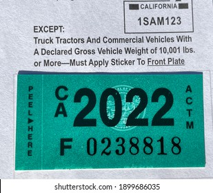 LOS ANGELES, DEC 26th, 2020: DMV Department of Motor Vehicles California registration tags 2022 sticker attached to renewal notice close up.