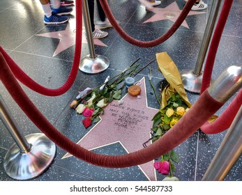 LOS ANGELES, DEC 28TH, 2016: Close-up of Carrie Fisher's memorial star on the Hollywood Walk of Fame, which was made by fans in tribute after her death of heart failure on Dec 27th, 2016.