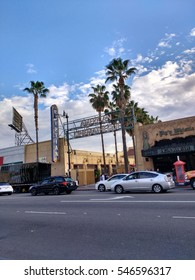 LOS ANGELES, DEC 29TH, 2016: Wide shot against blue, cloudy sky of Grauman's Egyptian Theatre, a historic movie theater in Hollywood on the Hollywood Walk of fame, which opened in 1922.