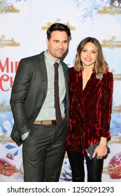 """LOS ANGELES - DEC 4:  Brett Dalton, Aimee Teegarden at the """"Once Upon A Christmas Miracle"""" Screening and Holiday Party at the 189 by Dominique Ansel on December 4, 2018 in Los Angeles, CA"""