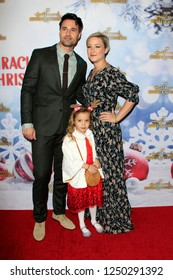 """LOS ANGELES - DEC 4:  Brett Dalton, wife, daughter at the """"Once Upon A Christmas Miracle"""" Screening and Holiday Party at the 189 by Dominique Ansel on December 4, 2018 in Los Angeles, CA"""