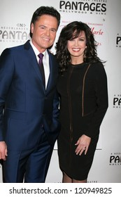 """LOS ANGELES - DEC 4:  Donny Osmond, Marie Osmond arrives to """"Donny & Marie - Christmas in Los Angeles"""" Opening Night at Pantages Theater on December 4, 2012 in Los Angeles, CA"""