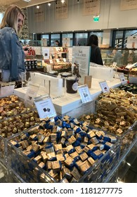 LOS ANGELES, Dec 9, 2017: A woman is looking over the large selection of expensive chocolate inside the Eataly store at the Westfield Century City shopping mall in Century City.