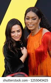 "LOS ANGELES, DEC 9, 2018: Actress Pamela Adlon with Angela Bassett, voice of ""Shatter"", on the red carpet at the global premiere of Paramount Pictures' Bumblebee, at the Chinese Theatre in Hollywood."