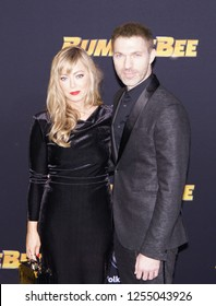 LOS ANGELES, DEC 9, 2018: Director Travis Knight (right) on the red carpet at the global premiere of Paramount Pictures' new movie Bumblebee, at the Chinese Theatre in Hollywood.
