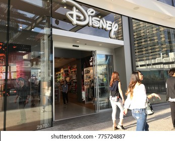 LOS ANGELES, DEC 9TH, 2017: People walk past the entrance to the Disney store at the newly opened Westfield Century City. Disney has made a billion dollar deal to buy most of 21st Century Fox.