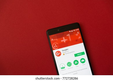 Los Angeles, december 11, 2017: Smartphone with Google plus application in google play store on red background