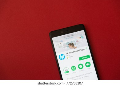 Los Angeles, december 11, 2017: Smartphone with HP print service plugin application in google play store on red background