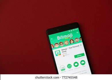 Los Angeles, december 11, 2017: Smartphone with Bitmoji  application in google play store on red background