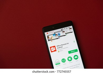 Los Angeles, december 11, 2017: Smartphone with Office remote application in google play store on red background