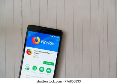 Los Angeles, december 15, 2017: Smartphone with Mozilla firefox application in google play store on wooden background