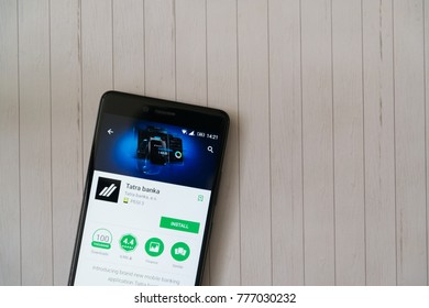 Los Angeles, december 15, 2017: Smartphone with Tatra banka application in google play store on wooden background