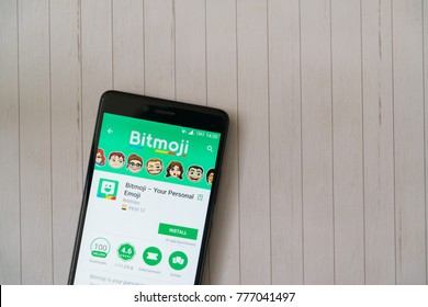 Los Angeles, december 15, 2017: Smartphone with Bitmoji application in google play store on wooden background