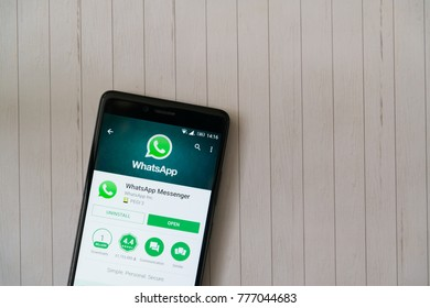 Los Angeles, december 15, 2017: Smartphone with Whatsapp application in google play store on wooden background