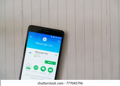 Los Angeles, december 15, 2017: Smartphone with Facebook messenger lite application in google play store on wooden background