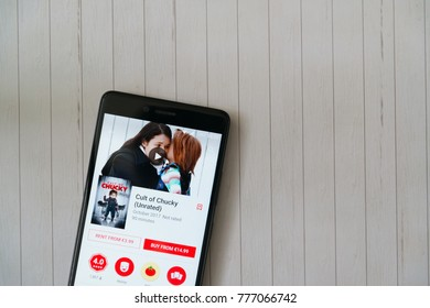 Los Angeles, december 15, 2017: Smartphone with Cult of Chucky movie in google play store on wooden background
