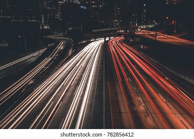 LOS ANGELES - DECEMBER 24, 2017: Freeway traffic shot with long exposure at night in downtown of Los Angeles, CA on December 24, 2017