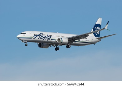 LOS ANGELES, DECEMBER 25, 2016: Alaska Airlines jet (Boeing 737) approaching LAX, Los Angeles World Airport.