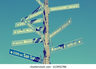 Los Angeles distance signs to its sister cities: Vancouver, Guangzhou, Bordeaux, Mumbai, Mexico City, San Salvador and Kaunas. Vintage filtered colors.