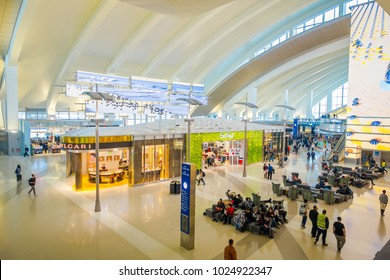 LOS ANGELES, EEUU, JANUARY, 29, 2018: Above view of unidentified people walking close to many stores inside of the airport of the Los Angeles International Airport LAX , the primary airport serving