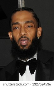 LOS ANGELES - FEB 10:  Emani Asghedom, Nipsey Hussle, Ermias Asghedom at the 61st Grammy Awards at the Staples Center on February 10, 2019 in Los Angeles, CA