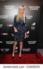 """LOS ANGELES - FEB 11:  Tara Reid at the """"The Hungover Games"""" Premiere at TCL Chinese 6 Theater on February 11, 2014 in Los Angeles, CA"""