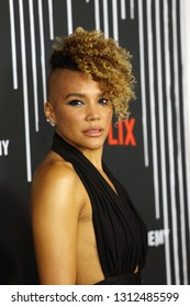 LOS ANGELES - FEB 12: Emmy Raver-Lampman at the premiere of Netflix's 'The Umbrella Academy' at ArcLight Hollywood on February 12, 2019 in Los Angeles, California,