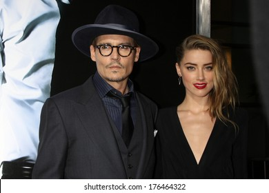 "LOS ANGELES - FEB 12:  Johnny Depp, Amber Heard at the ""3 Days to Kill"" LA Premiere at ArcLight Hollywood Theaters on February 12, 2014 in Los Angeles, CA"