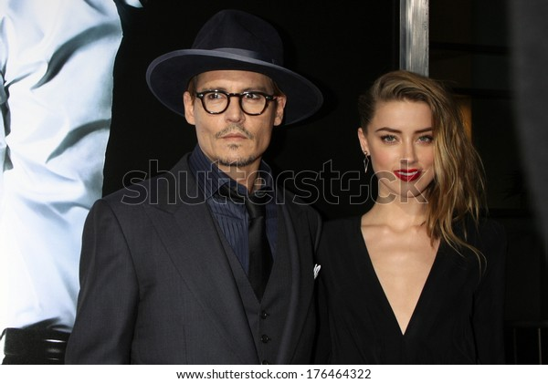"""LOS ANGELES - FEB 12:  Johnny Depp, Amber Heard at the """"3 Days to Kill"""" LA Premiere at ArcLight Hollywood Theaters on February 12, 2014 in Los Angeles, CA"""