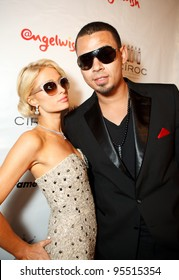 """LOS ANGELES - FEB. 12: Paris Hilton & Afrojack attend the """"Fame At The Mansion"""" 2012 Grammy Aterparty hosted by Sean """"Diddy"""" Combs at the Playboy Mansion in Los Angeles on Feb. 12, 2012."""