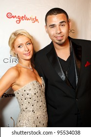 """LOS ANGELES - FEB. 12: Paris Hilton & Afrojack attends the """"Fame At The Mansion"""" 2012 Grammy Aterparty hosted by Sean """"Diddy"""" Combs held at the Playboy Mansion. Los Angeles, Feb 12, 2012"""