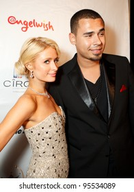 """LOS ANGELES - FEB. 12: Paris Hilton & Afrojack attend the """"Fame At The Mansion"""" 2012 Grammy Aterparty hosted by Sean """"Diddy"""" Combs held at the Playboy Mansion. Los Angeles, Feb 12, 2012"""