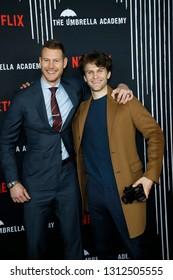 LOS ANGELES - FEB 12: Tom Hopper, Keegan Allen at the premiere of Netflix's 'The Umbrella Academy' at ArcLight Hollywood on February 12, 2019 in Los Angeles, California,