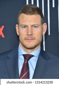 LOS ANGELES - FEB 12:  Tom Hopper arrives for the Netflix's 'The Umbrella Academy' Premiere - Season 1 on February 12, 2019 in Hollywood, CA