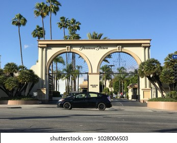LOS ANGELES, FEB 12th, 2018: Exterior shot of the famous Paramount Pictures gate at the entrance to the studio lot on Melrose Avenue in Los Angeles, on a sunny day, against a blue sky and palm trees.