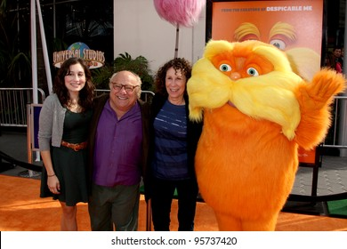 "LOS ANGELES - FEB 19:  Danny DeVito, Rhea Perlman, Daughter and Lorax arrives at the ""Lorax"" Premiere at the Gibson Ampitheatre on February 19, 2012 in Los Angeles, CA."
