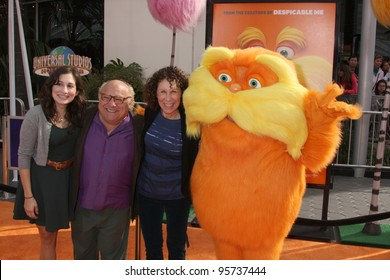 "LOS ANGELES - FEB 19: Danny DeVito, Rhea Perlman, and Lorax arrive at the ""Lorax"" Premiere at the Gibson Ampitheatre on February 19, 2012 in Los Angeles, CA."