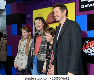 "LOS ANGELES - FEB 2:  Milla Jovovich, Paul W.S. Anderson, Ever Anderson at ""The Lego Movie 2: The Second Part"" Premiere at the Village Theater on February 2, 2019 in Westwood, CA"