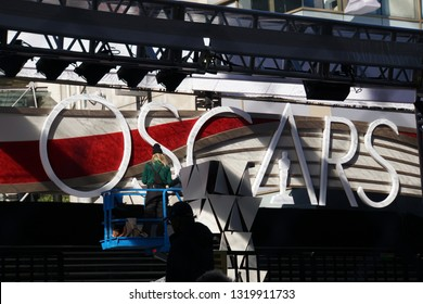 """LOS ANGELES, Feb 21st, 2019: A worker on a construction lift puts the finishing touches on the """"Oscar"""" sign on the red carpet, for the 91st Academy Awards Oscar ceremony held at the Dolby Theatre."""