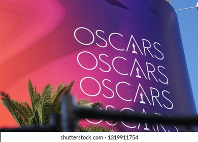 "LOS ANGELES, Feb 21st, 2019: The words ""Oscars"" on a red background next to a palm tree, advertising the 91st Academy Awards Oscar ceremony held at the Dolby Theatre on Hollywood Boulevard."