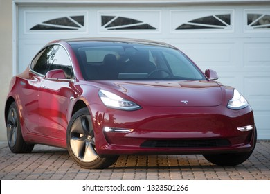 LOS ANGELES - FEB 23: A Tesla Model 3 in a driveway in front of a garage.  The Model 3 is the top selling electric vehicle in the US.