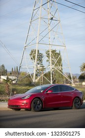 LOS ANGELES - FEB 23: A Tesla Model 3 in front of a power line.  The Model 3 is the top selling electric vehicle in the US.