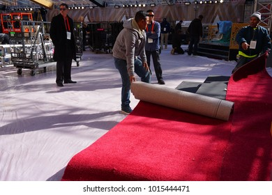 LOS ANGELES, FEB 23RD, 2017: Workers unfurl the red carpet during preparations for the 2017 Academy Awards.